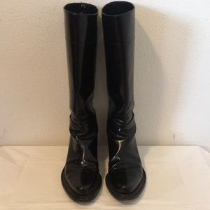 Prada black leather riding boots.